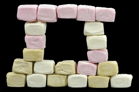 colored window: front with window made from different colored marshmallow cubes Stock Photo