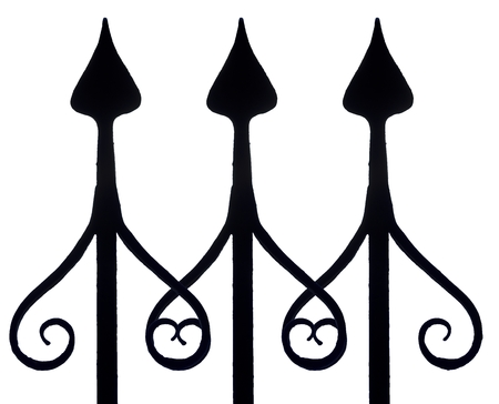 ironwork: pattern made by three iron fence posts with artfully formed tips, isolated