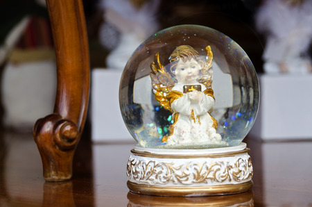 snowdome: snow bowl with white angel with golden wings