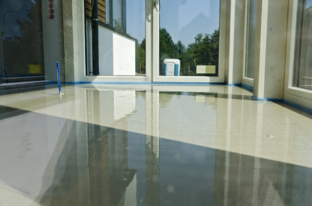 room with fresh liquid floor screed at a porch Reklamní fotografie