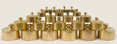 hallmark: weights made from brass with hallmarks staked like a pyramid Stock Photo
