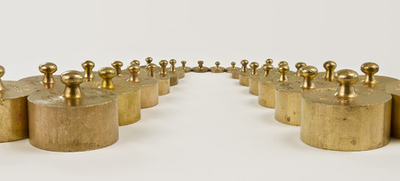 calibrated: weights made from brass with hallmarks in rows