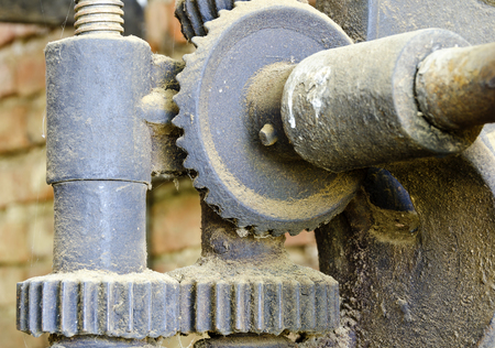 antiquated: old iron gearing mechanism with diverse cogs Stock Photo