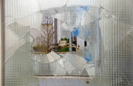 wired: view through a hole in a pane of wired glass