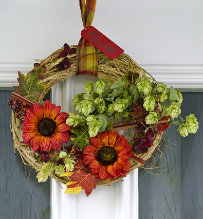 autumnally: autumnally door decoration with straw wreath and hops