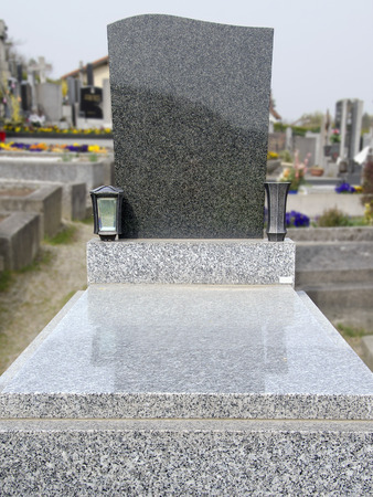 stonemason: grave with base, cover and gravestone made from granite Stock Photo