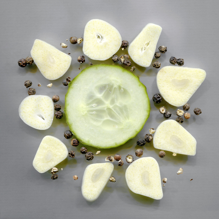 cloves: cucumber slice, garlic cloves and black peppercorns Stock Photo