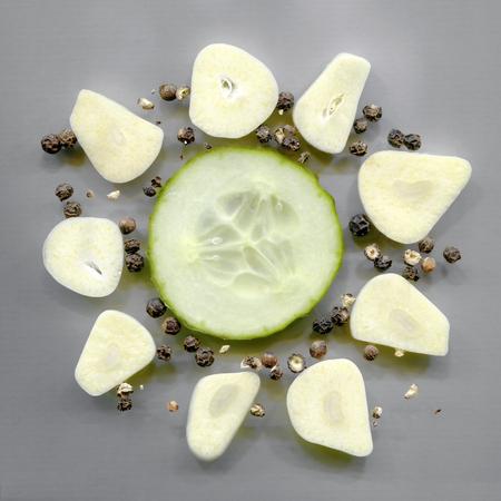 peppercorns: cucumber slice, garlic cloves and black peppercorns Stock Photo