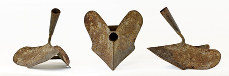 plough: three views of an old rusty iron hand plough