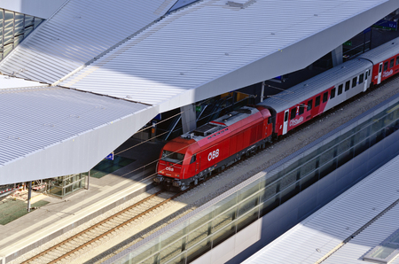 steelwork: view on a red city shuttle train of the austrian federal railway at the new Viennese main train station, 2014, Vienna, Austria