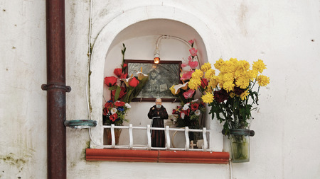 godliness: house altar at a wall, Cefalu, Sicily, Italy