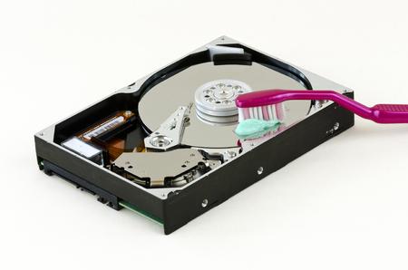 harddisk: opened harddisk with red toothbrush Stock Photo