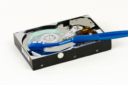 fixed disk: opened harddisk with blue toothbrush and toothpaste