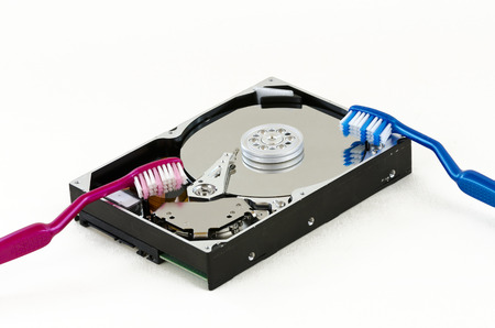 harddisk: opened harddisk with two toothbrushes Stock Photo