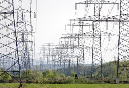 multiple: rows of power poles with multiple high-voltage power lines Stock Photo