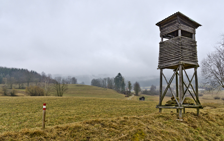 dull: landscape of the region Waldviertel with high seat and boundary mark at dull weather, Austria Stock Photo