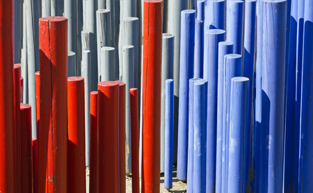 wood pillars: red, gray and blue painted wooden rods