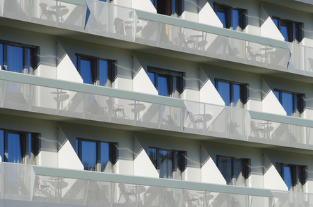 perforated: front of a modern hotel with balconies