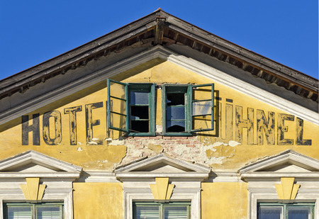 ruinous: gable of the ruine of an old station hotel with broken windows at a small town, Rekawinkel, Austria