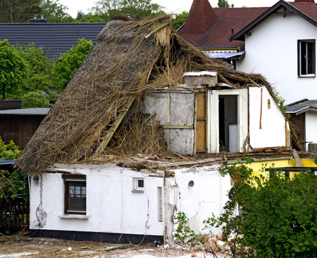 house demolition: demolition of a reed covered house at Zingst, Germany