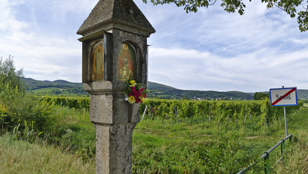 stony: stony piety column before vine yard and village limit sign, Soos, Austria Stock Photo