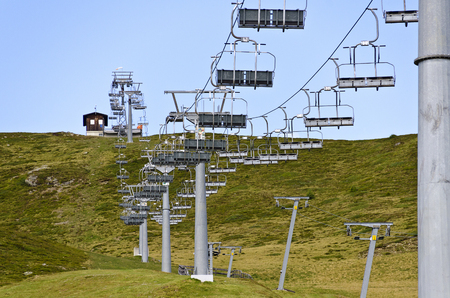 out of service chair lift on a ski lope in summer, Tyrol, Austria Stock Photo