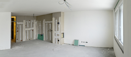 living room with kitchen corner made by plasterboards at a residential building under construction Editorial