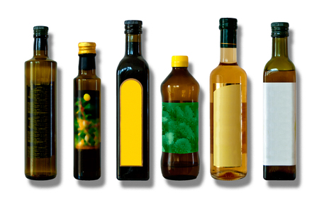 six different bottles for vinegar and oil, isolated Stock Photo