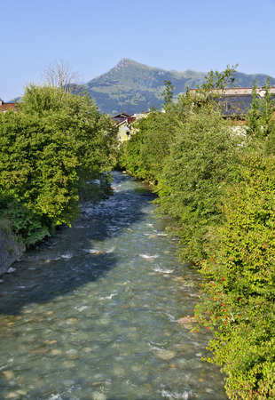 view from the creek Reither Ache in the village of Kirchberg to the peak Kitzbueheler Horn in Tirol, Austria Stock fotó