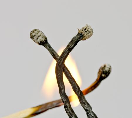 Near view of three black burnt down matches Reklamní fotografie