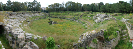 ruins of the roman amphitheatre at the archaeologic park of Syracuse, Sicily, Italy Stock Photo