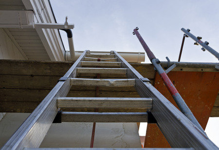 old metallic ladder as ascent to a scaffold