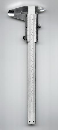 glossy metallic sliding caliper isolated on gray