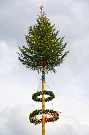 colorful decorated maypole against the sky at the village of Poeggstall, Austria