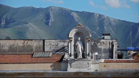 Madonna statue on the roof in Palermo, Sicily, Italy