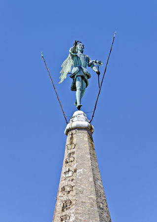 statue of the archangel Michael at the spire of the basilica Saint Eufemia at Grado, Italy