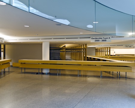 Empty entrance hall with coat racks for visitors Stock Photo