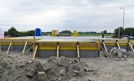fresh  concreted base plate with formwork of a single-family house