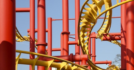 Red and yellow painted steel construction of a roller coaster