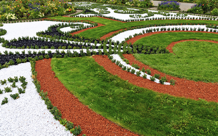 ornamental borders made by grass and colored stones at the ground floor of a baroque garden  in the palace Schlosshof, Austria