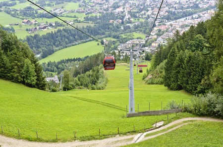 gondola of the cableway to the castle mountain hoovering over a road way, Lienz, Eastern Tirol, Austria