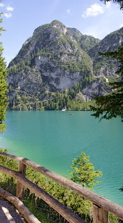 view from the foot path across the lake Prags to the great Apostle  at the eastern shore, South Tirol, Italy Stock Photo