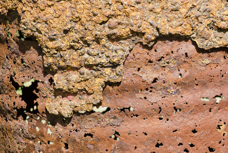 corroded rusty hull with holes of a steel barrel