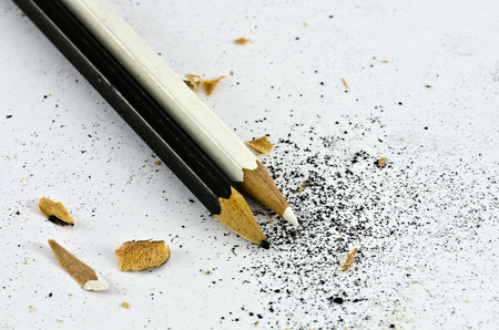 Black and white coloured pencils with chippings of wood and cores