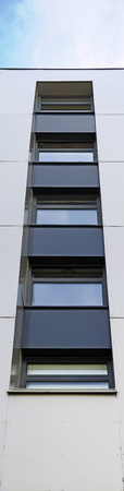 Vertical row of windows at a modern house front