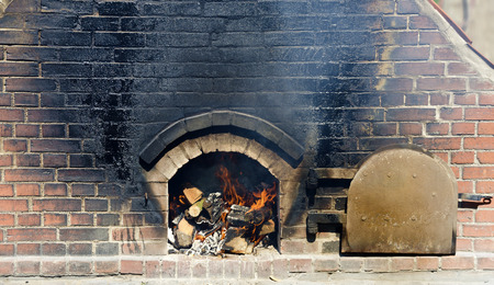 fire in a brick-built baking oven with sooty wall