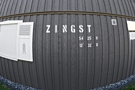 wooden wall with geographic position information of the village of Zingst, Germany