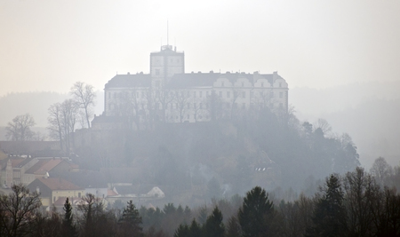 view to the renaissance palais Weitra of the family Fuerstenberg at fog, Austria Stock Photo