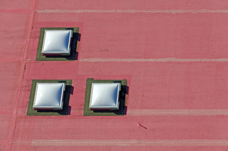 three domed rooflights on a red flat roof, Vienna, Austria