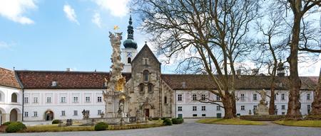 HEILIGENKREUZ, AUSTRIA - MARCH 20, 2011:  inner yard of the Cistercian monastery Heiligenkreuz abbey with trinity column